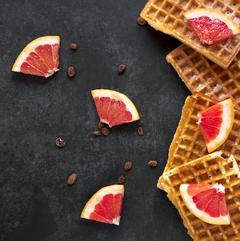 Flat lay of waffles with citrus