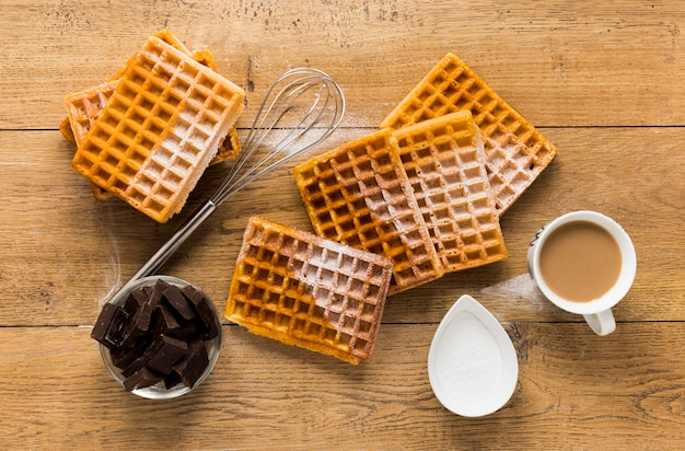 Flat lay of waffles with coffee and chocolate