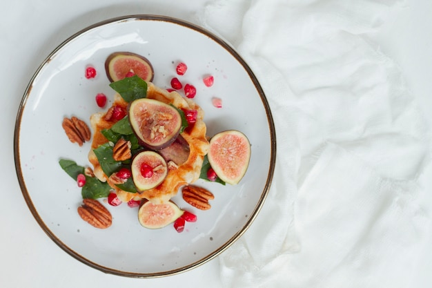 Flat lay waffles with figs and nuts