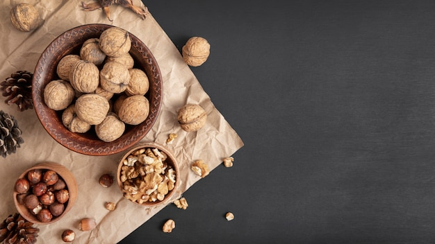 Flat lay of walnuts in bowl with hazelnuts