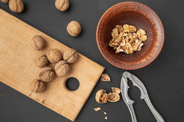 Flat lay of walnuts with cracker