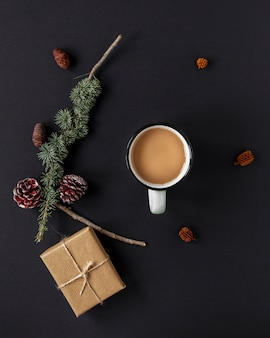 Flat lay warm beverage next to christmas decorations