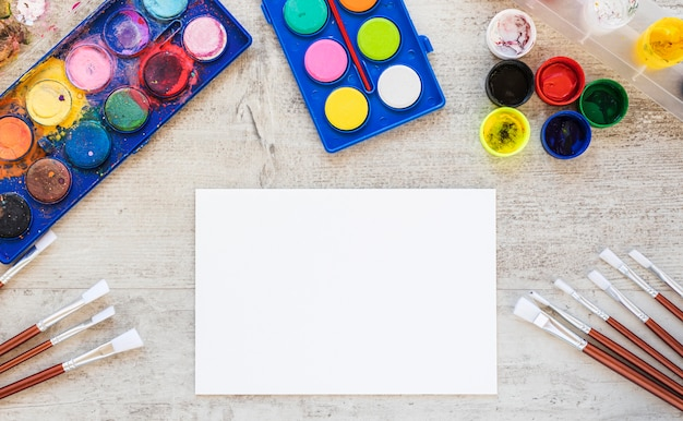 Flat lay watercolor paint white paper