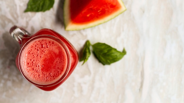 Flat lay watermelon juice in glass jar