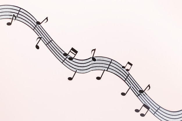 Flat lay wavy musical notes with pink background
