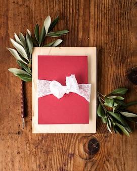 Flat lay wedding card on table