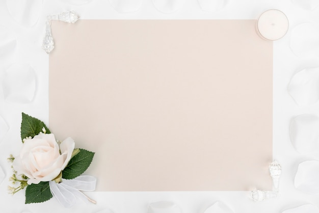 Flat lay wedding card with white flower decoration