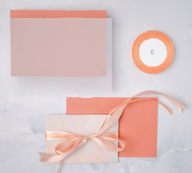 Flat lay wedding composition with minimalist invitations mock-up