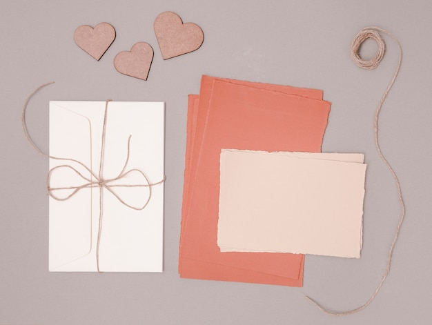 Flat lay wedding decoration with invitations and ornaments