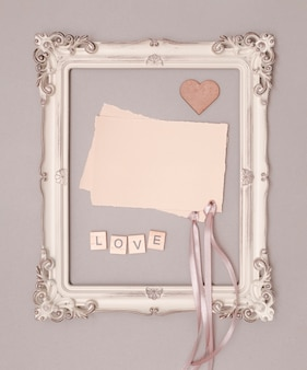 Flat lay wedding invitation mock-up in vintage frame