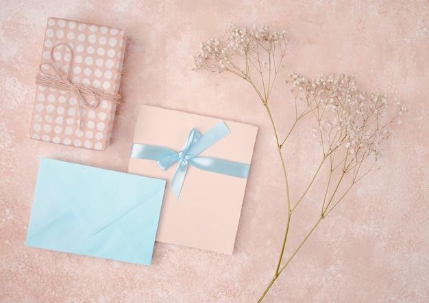 Flat lay wedding invitation with blue envelope