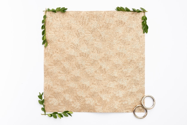 Flat lay wedding rings with greeting card