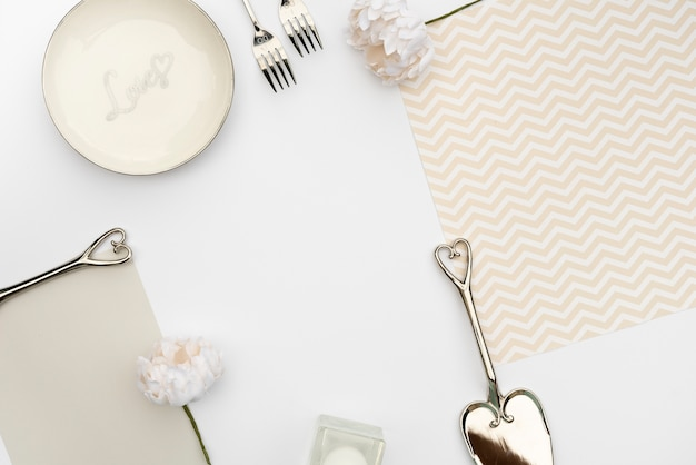 Flat lay wedding table design with cutlery