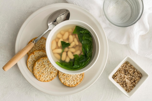 Flat lay white beans soup with crackers