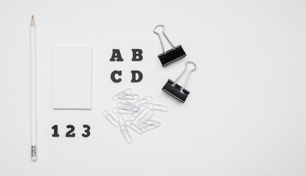 Flat lay white and black stationery office supplies