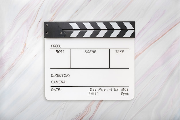 Flat lay of white clapboard on marble background. clapper board on marble texture