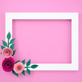 Flat lay white floral frame on pink background