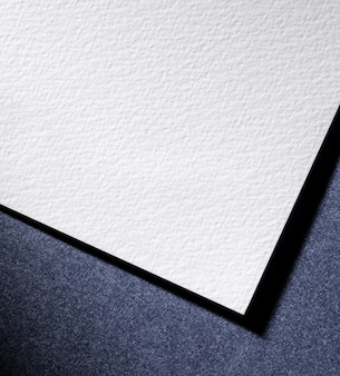 Flat lay white paper on blue background