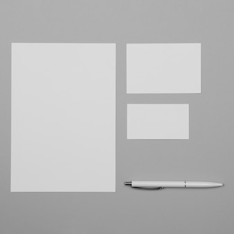 Flat lay white paper sheet with pen