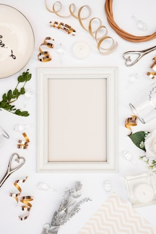 Flat lay of white wedding frame with decorations