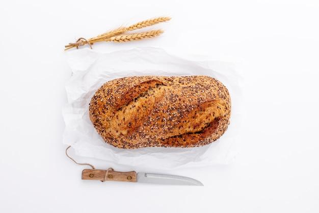 Flat lay wholegrain bread and knife