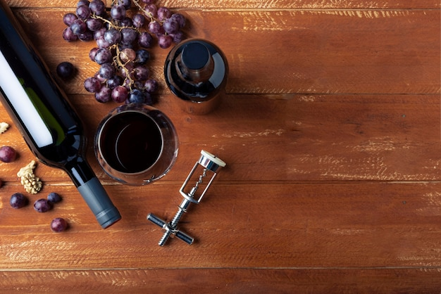 Flat lay wine bottle and glass with corkscrew