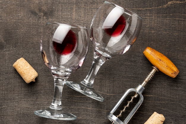 Flat lay wine glasses and corkscrew on table