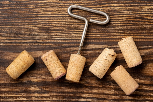 Flat lay wine stopper collection beside corkscrew