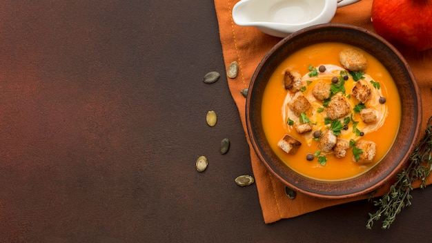 Flat lay of winter squash soup in bowl with copy space