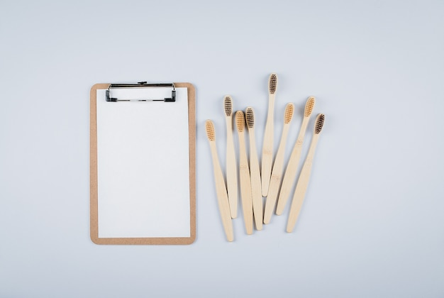 Flat lay with bamboo toothbrushes and empty blank for text zero waste,ept