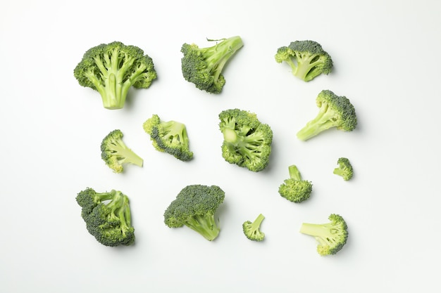 Flat lay with broccoli on white surface