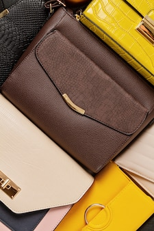 Flat lay with collection of woman handbags. shopping, fashion look, online beauty blog, sale concept