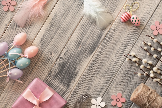 Flat lay with copy-space  on grey textured wooden surface with spring decorations