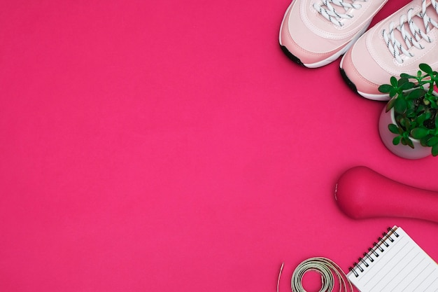 Flat lay with diet diabetes weight loss concept. sneakers, tape measure, glucometer on a pink