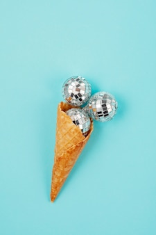 Flat lay with disco balls in the cone