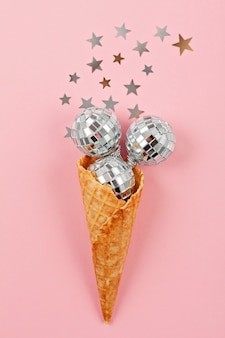 Flat lay with disco balls in the waffle cone