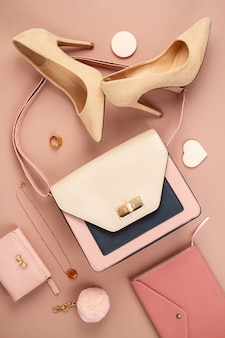 Flat lay with elegant woman accessories, hand bag and high heel shoes