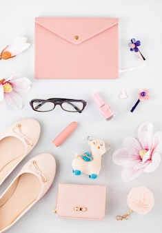 Flat lay with girls spring summer accessories in pink pastel tones. casual urban summer style