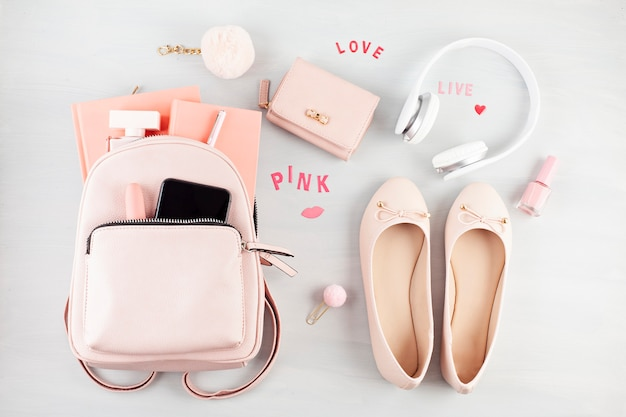 Flat lay with girls spring summer accessories in pink pastel tones.