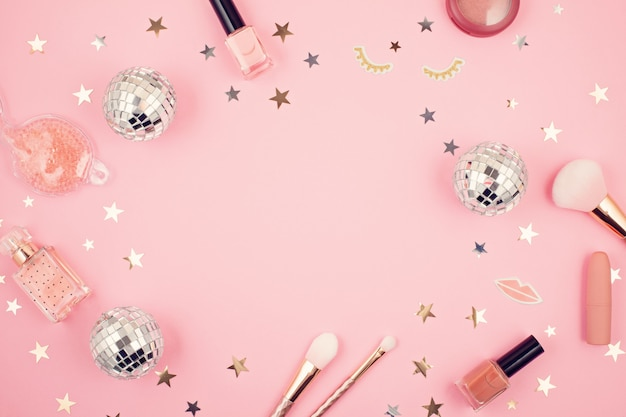 Flat lay with glamour girls accessories over pink background