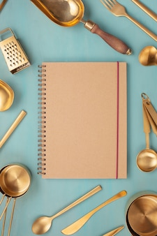 Flat lay with kitchen utensils and blank copy space. kitchen recipe books, cooking blogs, classes concept