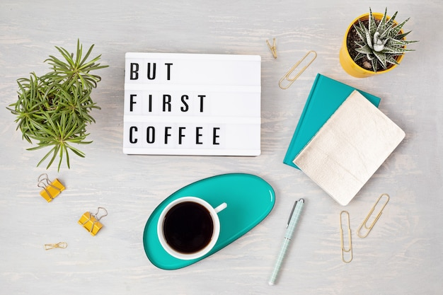 Flat lay with lightbox with text but first coffee and coffee cup. social media, feminine blog, morning of workday concept. top view