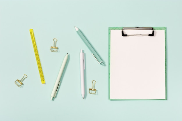 Flat lay with mock-up notebook and stationery for school or office.