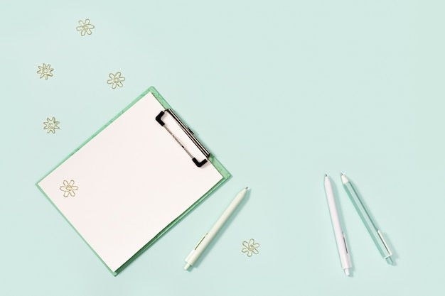 Flat lay with mock-up notebook and stationery for school or office