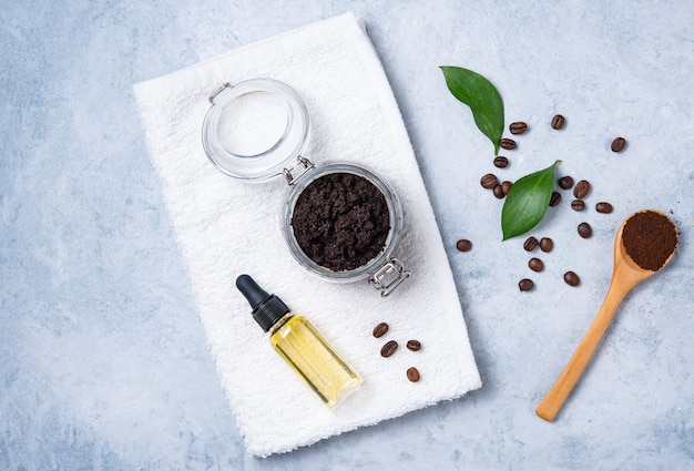 Flat lay with natural ingredients for home body coffee scrub with coffee beans