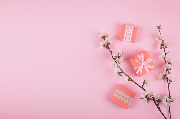 Flat lay with pink gift boxes