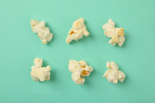 Flat lay with popcorn on mint space. food for cinema