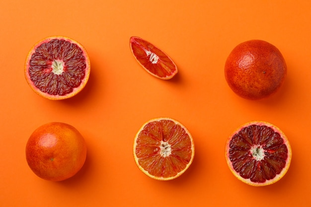 Flat lay with red oranges on orange