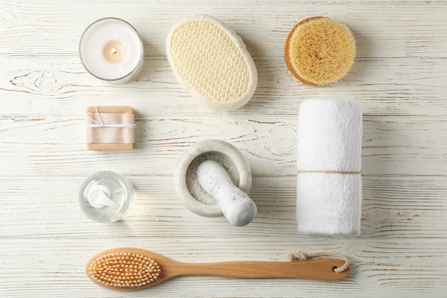 Flat lay with spa accessories on white wood. bodycare