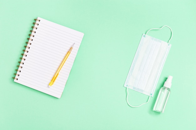 Flat lay with stationery for school, education and personal protective equipments.